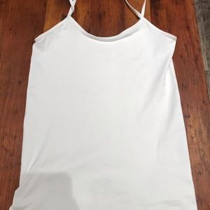 The limited white Cami Size: medium .